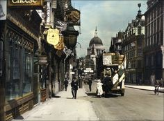 "Fleet Street looking towards Ludgate Circus, London, with St Paul's Cathedral in the background. The pub on the left, Ye Olde Cheshire Cheese (You can just see the bottom of the word ""Cheese"" in the top left of the photo) is still there."