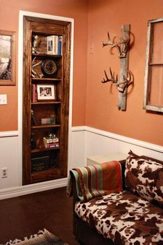 ok....this is about the bookshelf..but I LOVE the old wood with the deer antlers!!