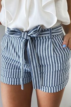 Love neutrals (navy and cream) together, stripes, and a little bit of femininity with the bow!