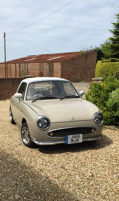 Nissan figaro topaz mist with alloy wheels