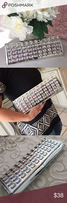 Steve Madden✨Metallic Clutch Gorgeous bling clutch, iridescent rhinestone front. Great condition. Steve Madden Bags Clutches & Wristlets