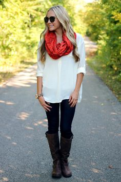 bold scarf, boots, skinnies, and a loose neutral blouse