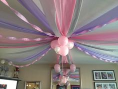 Baby girl's first birthday ceiling decorations. Cut plastic table clothes, crape paper streamers and balloons.