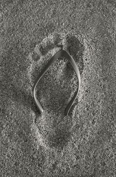 Grey   footprint in the sand