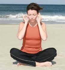 In the same standing position, pull the ears up, down and out using your hands and fingers