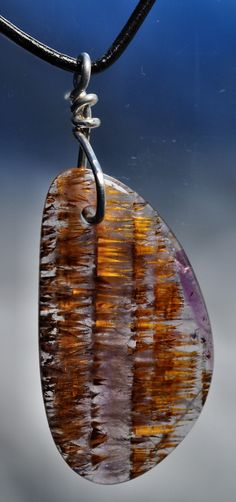 Cacoxinite Melody's Stone talisman pendant   Super Seven 7   Amazing golden cacoxinite in amethyst
