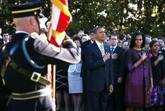 The 11th anniversary of the Sept. 11 terrorist attacks    Sept. 11, 2012     President Obama and first lady Michelle Obama observe the moment of silence with White House staff members on the South Lawn of the White House.