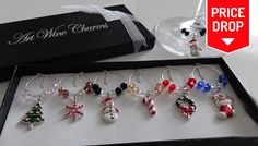 6 Christmas-Themed Wine Glass Charms Put your glass down and can't remember which one it is? No need to worry...      These 6 Christmas Wine Glass Charms make your mulled wine even more festive      These cute charms go around the stems of your wine glasses so you can identify yours.      Mixed charms include snowman, tree, candy cane, snowflake, wreath and stocking      Brighten up your...
