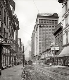 """St. Louis, Missouri, circa 1900. """"Olive Street west from Sixth."""" 8x10 inch dry plate glass negative, Detroit Publishing Company."""
