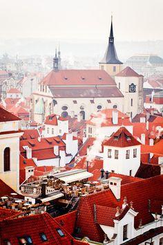 A rooftop restaurant offers fantastic views over de Prague's old town in Czech Republic