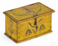 Winning bid:$4,200  Jacob or Jonas Weber (Lancaster County, Pennsylvania, mid 19th c.), painted pine trinket box with floral decoration on a yellow ground, 2 1/2'' h., 4 1/2'' w. Provenance: Dietrich Collection. - Price Estimate: $2000 - $4000