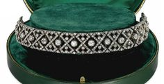 A LATE 19TH CENTURY DIAMOND TIARA/CHOKER NECKLACE.  Of bandeau form, designed as an old-cut diamond-set pierced lattice set with a central row of cushion shaped diamond collet highlights, to pointed trefoil terminals, mounted in silver and gold, circa 1890, Hancocks & Co. fitted case, with brooch and choker necklace fittings and screw driver