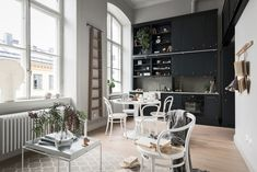 Small loft with black kitchen