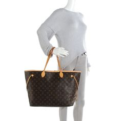 This is an authentic LOUIS VUITTON Monogram Neverfull GM. This chic tote is finely crafted of signature Louis Vuitton monogram on coated canvas in the largest size. This bag features vachetta cowhide leather top handle shoulder straps, side cinch cords and trim complimented by polished brass hardware. The wide top opens to a striped beige fabric interior with a hanging zipper pocket. This is an excellent handbag for day or travel, from Louis Vuitton!