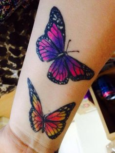Butterflies. Orange and black. Purple blue and pink