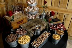 The groom's table!! We spelled out his name with the big letters and then bought the tin cans in different sizes and did assorted chocolates...like a general store theme...flavored popcorns, peanut butter cups, smores, etc.