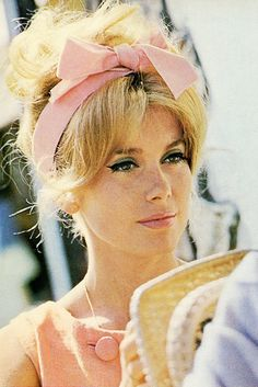 Catherine Deneuve 1965 pink bow headband with messy bun
