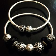 PANDORA Bangles with Cute Silver Charms and Black Faceted Murano.