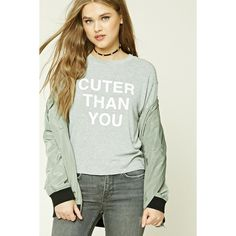 Forever21 Cuter Than You Graphic Top ($16) ❤ liked on Polyvore featuring tops, green top, green long sleeve top, crew neck top, boxy tops and graphic tops