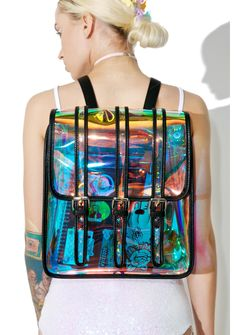 Current Mood Galactic Backpack is gunna bounce those lazer beams off yer back, bb! This supa cool backpack features a shiny transparent iridescent rainbow construction, roomy box shape, top flap closure with three buckled straps, black vegan leather trim, and adjustable shoulder straps.