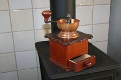 Vintage Douwe Egberts coffee grinder with copper door HomiArticles