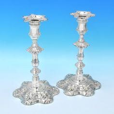Hallmarked in Sheffield, 1828 by Kirby Waterhouse & Co. This attracitve, George IV Antique, Sterling Silver Pair of Candlesticks, are in the 'Six Shell' style, and feature removable sconces. Each candlestick measures 9 inches