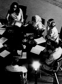 Joan Crawford (top left) and Bette Davis (right, with cigarette) at a reading…