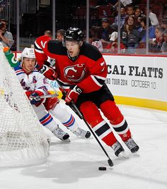 Jon Merrill #7 of the New Jersey Devils skates against the New York Rangers at the Prudential Center on October 4, 2014 in Newark, New Jersey. The Devils shutout the Rangers 3-0. (Photo by Bruce Bennett/Getty Images)
