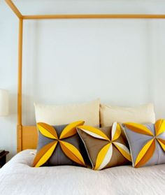 Felt Flower Pillows DIY: Beautiful, especially in this layout.