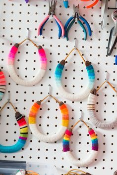 A Playful, Rainbow-Hued LA Studio Apartment Is Tiny But Well Designed: gallery image 19 Horseshoe Crafts, Horseshoe Art, Old Macdonald Birthday, Ikea Kallax Shelving, Studio Apartment, Apartment Therapy, Cowboy Party, Rainbow Crafts, Horse Crafts
