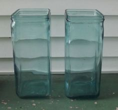 Up for bid I have a pair of very old glass battery jars. These are in good condition except for a chip on the top edge of one jar. These are aqua colored glass. On the bottom are the following numbers and letters: W H 2 G 4 11 1/2 13