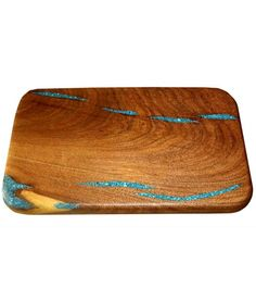 Gift Idea: Turquoise Inlay Cutting Board - Meal prep just got a whole lot prettier. Pull out a cutting board with inlaid turquoise swirled into the grain pattern of the mesquite wood and get chopping. http://rusticartistry.com/product/turquoise-inlay-cutting-board-large/