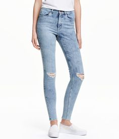 5-pocket, ankle-length jeans in washed superstretch denim with heavily distressed details. High waist and slim legs.