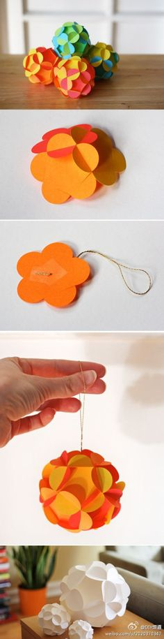 3-D paper ball ornaments with instructions and printable templates for download, by How About Orange: Made from 12 slotted flower shapes that fit together to form a sphere. No adhesive needed; the only ingredient is paper.