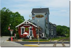 "The red building hosts ""Off the Rail,"" serving breakfast and lunch, baked goods and specialty coffees, Elkhart Lake, WI"