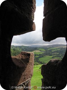 View through arrow hole of Carreg Cennen Castle, Wales, UK; the castles on Wales are all stunning...