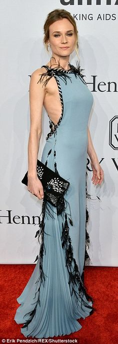 Detail orientated: Giving the gown a fashion edge, on the side of its skirt the smooth fab...