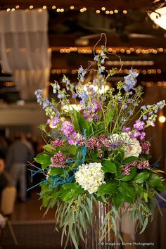 Fun eclectic, purple flower arrangement   A Joyful Athens Wedding   Blume Photography