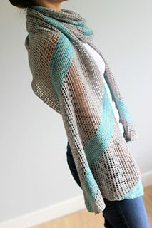 The breezy skies wrap is knit entirely on the bias, alternating garter stripes and mesh sections. It's also reversible, like most of my accessories. And the best part? No long cast on or cast off and no purling!