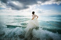 Trash the dress session on a beach is definitely on the to do list! I love the bride running into the waves!