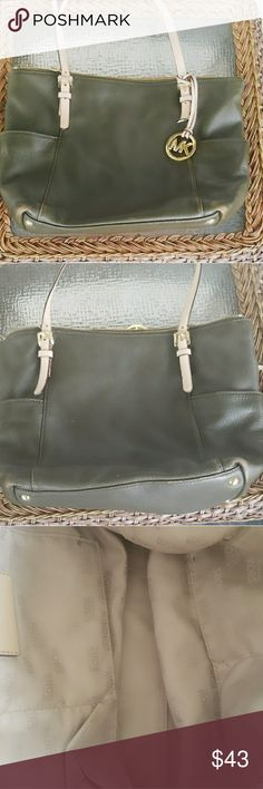 Michael Kors Purse Pre owned..color is like a coffee brown with tan lining inside.A few small stains im bottom of purse.Beautiful bag! Michael Kors Bags Shoulder Bags