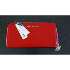 Karen Millen Wallet This is a beautiful red Karen Millen Saffiano zip around wallet. The wallet is new with tags. The inside features a center zip up coin pocket, a large bill slot on each side as well as 4 card slots per side. Karen Millen Bags Wallets