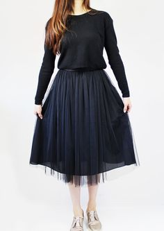 You can still go for a feminine look without involving pink.  This black tulle midi skirt makes it so easy to merge romantic and edgy, or classic and fun.  Absolutely street-style-worthy!