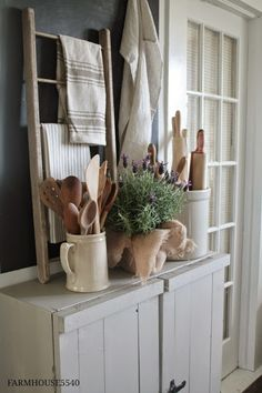 Like the idea of this small ladder and displaying vintage/favorite linens. Vintage Linens and Wooden Utensils - displayed in the kitchen on a rustic sideboard - via FARMHOUSE Farmhouse Friday ~ Farmhouse Kitchen Primitive Kitchen, Farmhouse Kitchen Decor, Farmhouse Style, Modern Farmhouse, Cottage Farmhouse, French Farmhouse, Primitive Decor, Italian Farmhouse Decor, Rustic French Country