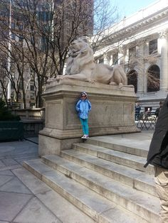 At New York Public Library with  Felix's favorite bibliophile and the notable marble lions, Patience and Fortitude.