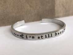 IM STILL HERE hand stamped cuff bracelet #stampedjewelry #awareness #suicideawareness #encourage #inspire #blissfulbird #jewelry #accessories #toptrend