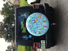Lilly Pulitzer custom painted Jeep spare tire cover Photo By: Emily Laskowski Jeep Covers, Jeep Spare Tire Covers, Jeep Tire Cover, Jeep Wrangler Camper, Jeep Tj, Painted Tires, Cruiser Boat, Jeep Accessories, Car Mats