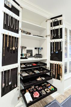 Chic closet features a double door cabinet, with inside of cabinet doors lined with stacked ...
