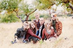 Great example of how to coordinate outfits for a family or group photo. Layers, same color families, but not super matchy. They got it right!