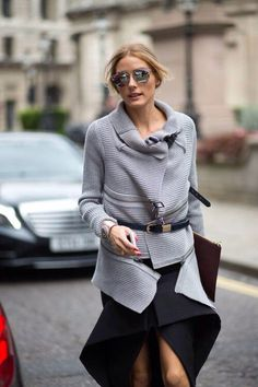 womens street style fashion: Olivia Palermo zip knitted sweater cardigan, brown leather clutch, black skirt (nb)